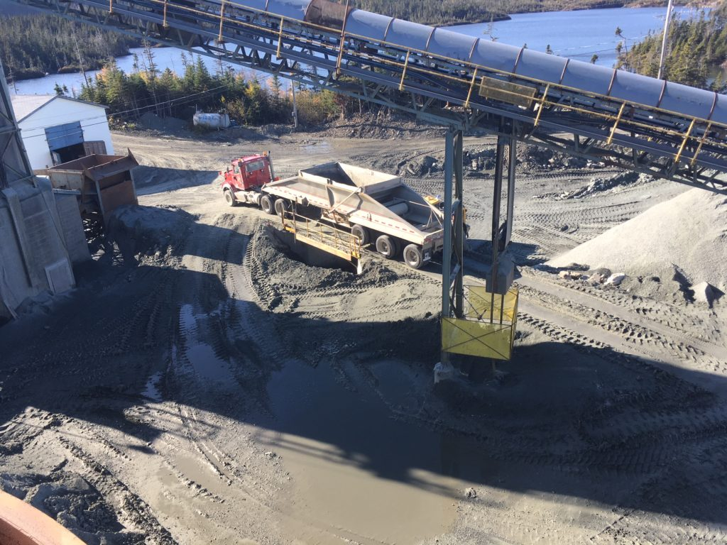 Copper ore being dumped at Nugget Pond